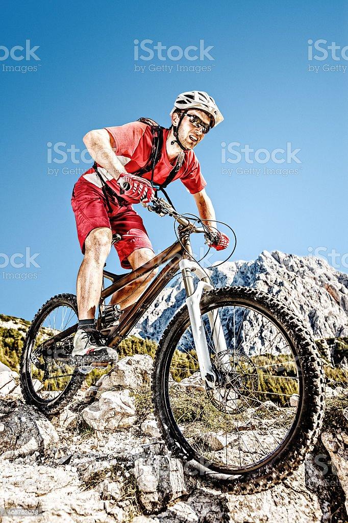 Mountainbiker on steep trail stock photo
