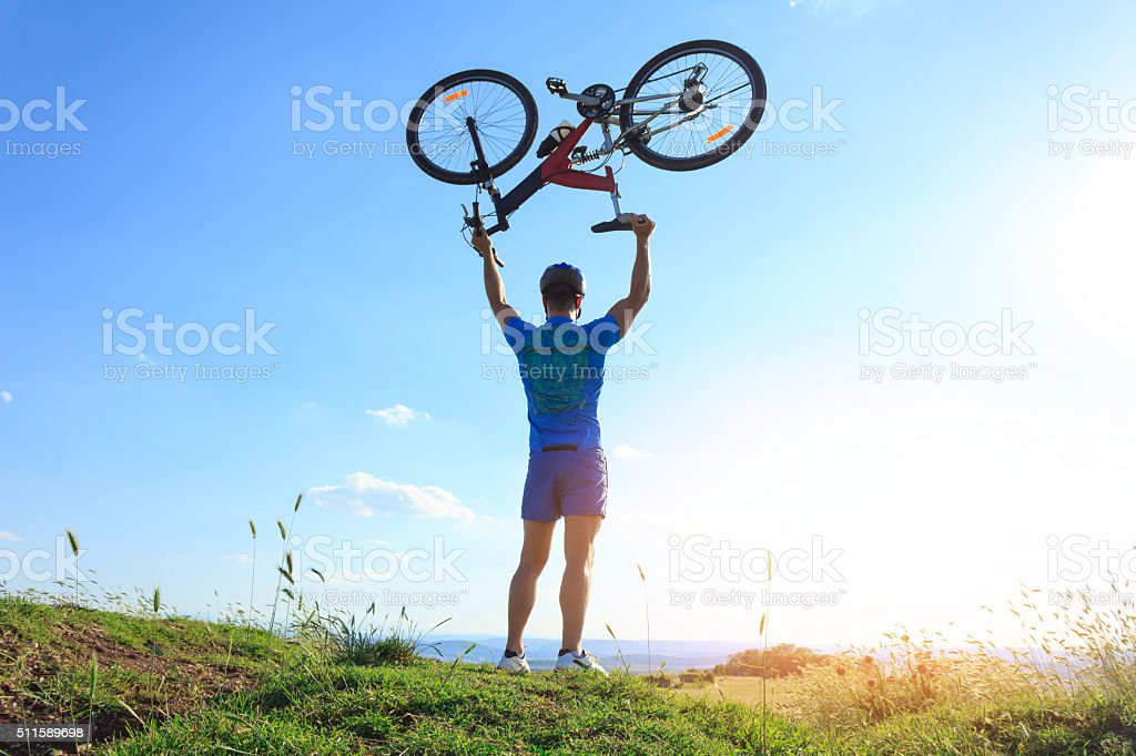 Mountainbiker on top of the hill stock photo