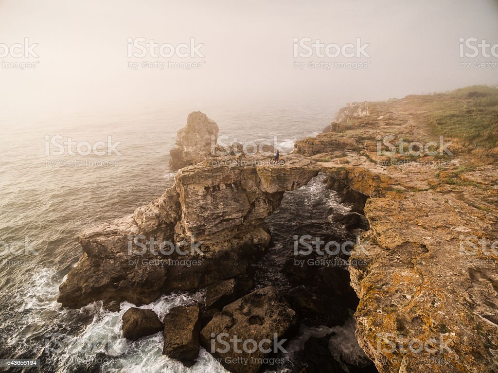 Mountainbiker on top of the rock stock photo