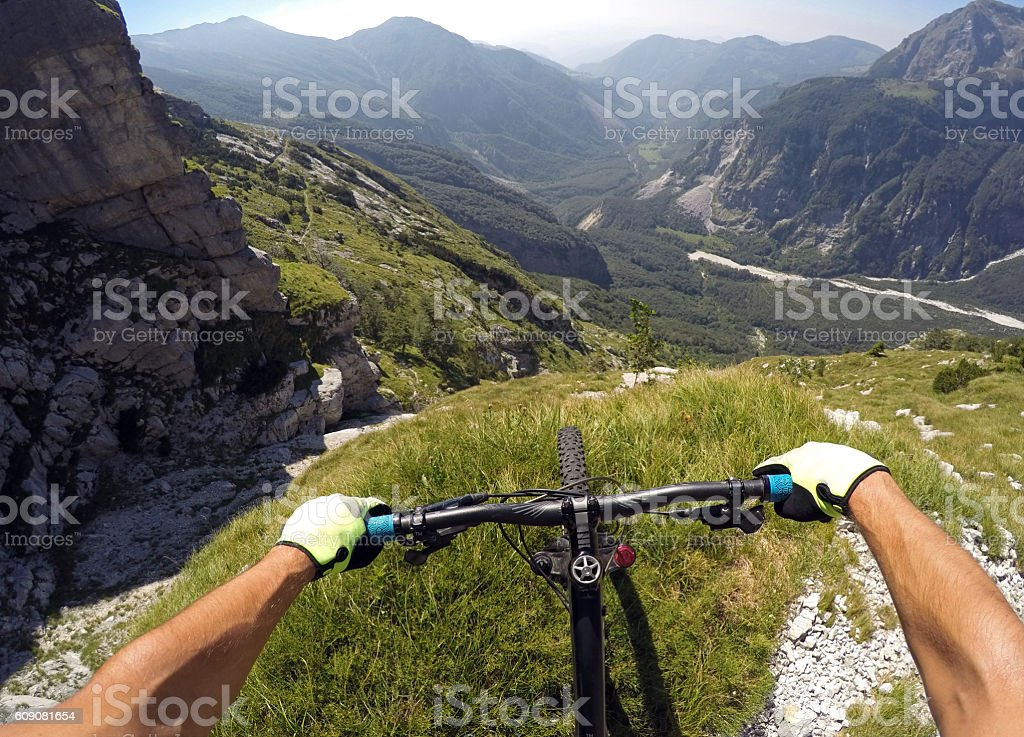 Mountainbiker over the valley stock photo