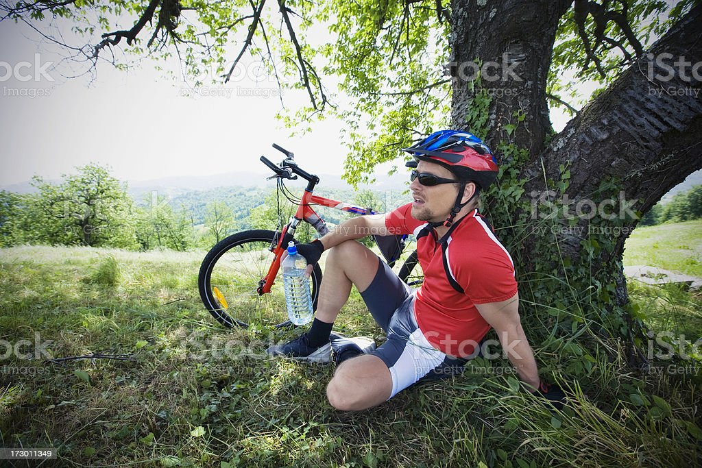 Mountainbiker resting royalty-free stock photo