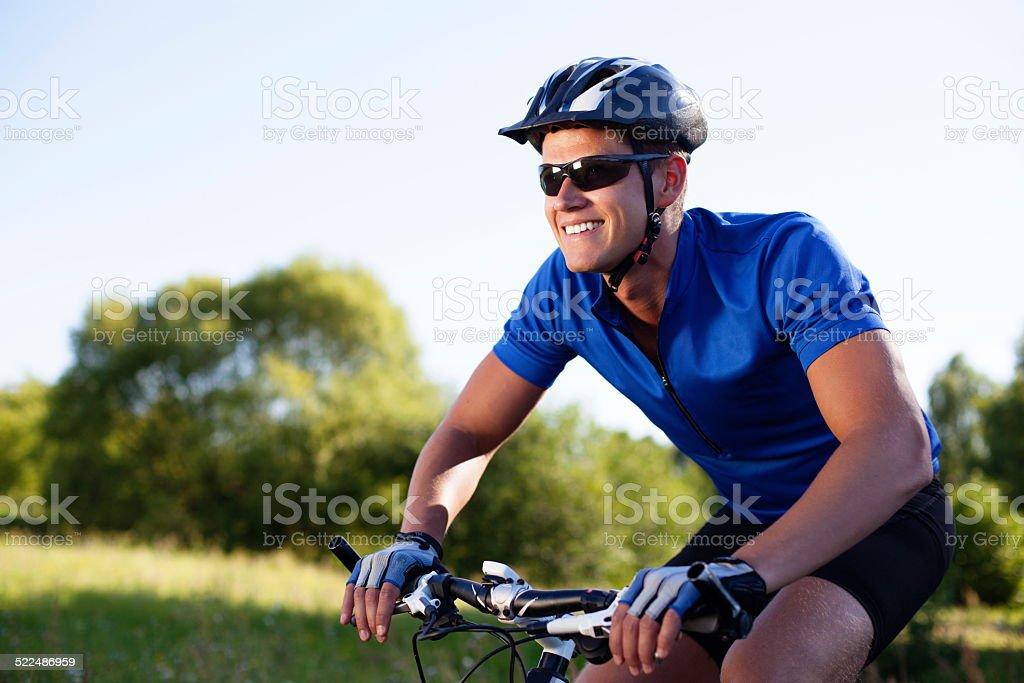 Mountainbiker riding bike stock photo