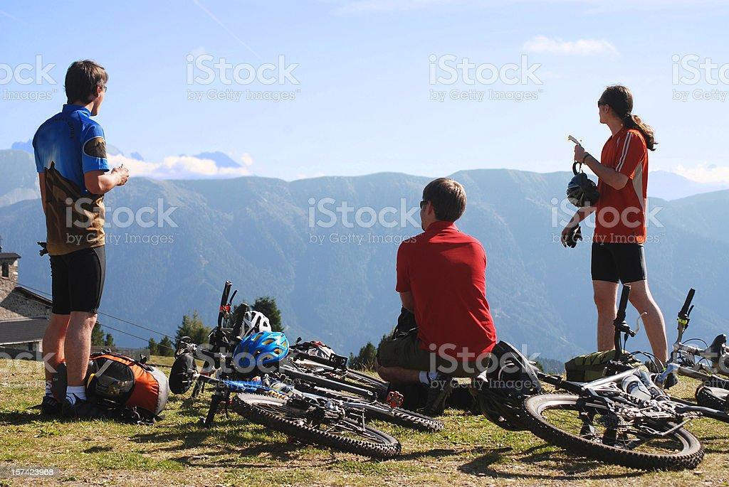 mountainbiker sightseeing in the alps stock photo