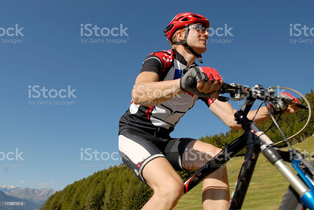 Mountainbiker uphill royalty-free stock photo