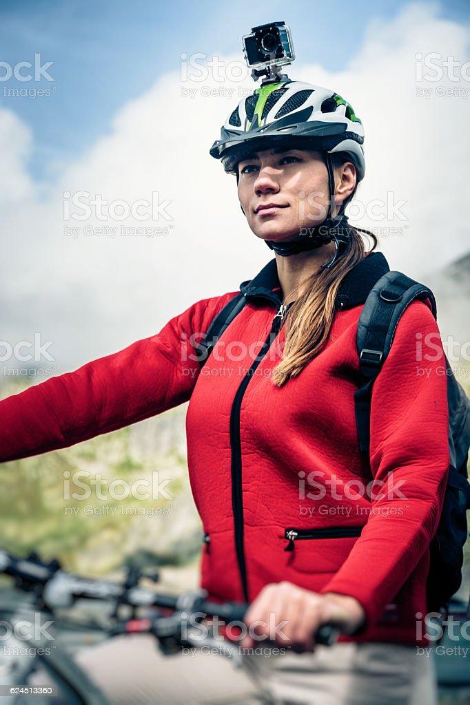 Mountainbiker with Actioncam on Helmet stock photo