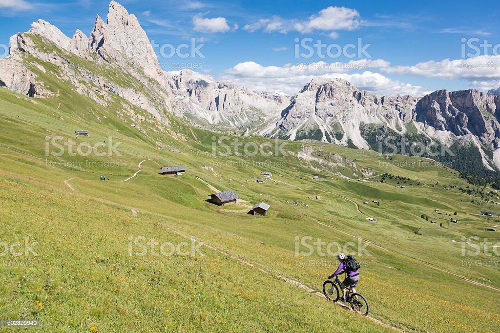Mountainbiking at Dolomite pastures, Italy stock photo