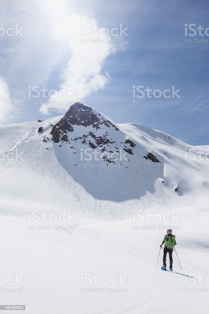 Mountaineer and mountain in the background stock photo