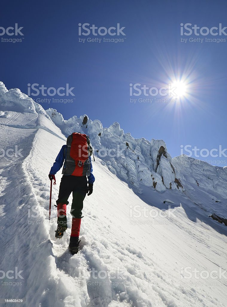 Mountaineer ascending stock photo