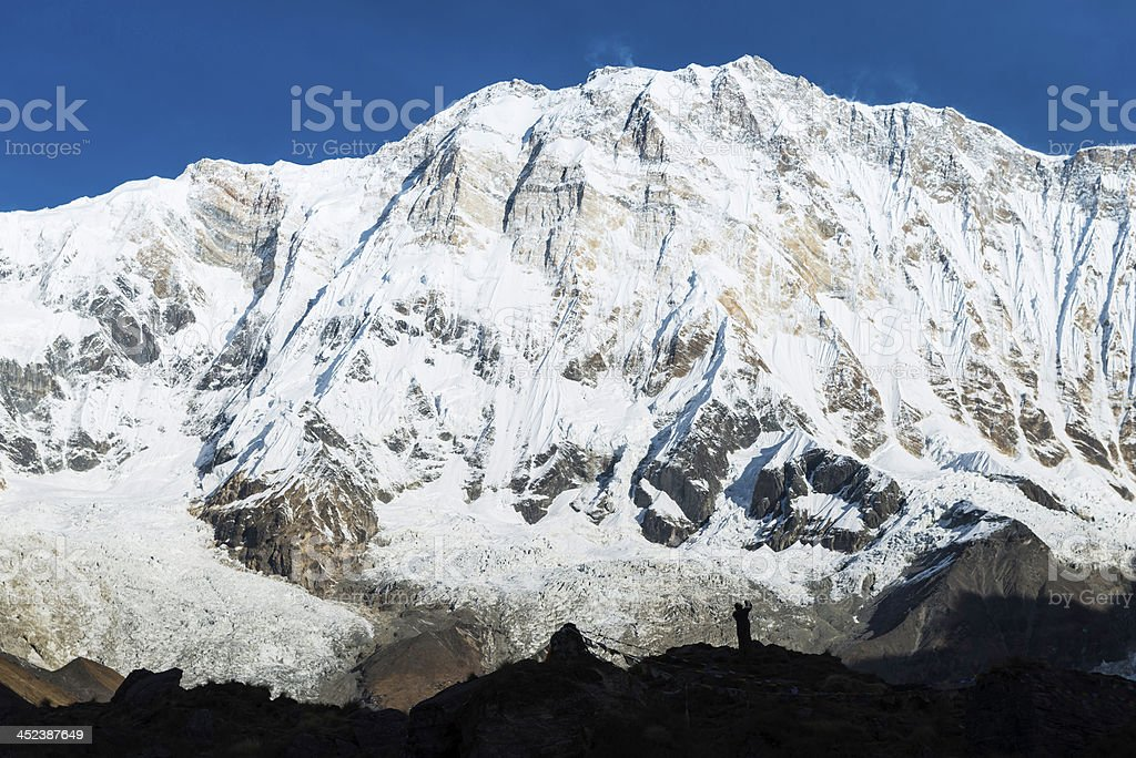 Mountaineer at base camp below Annapurna I 8091m Himalayas Nepal royalty-free stock photo