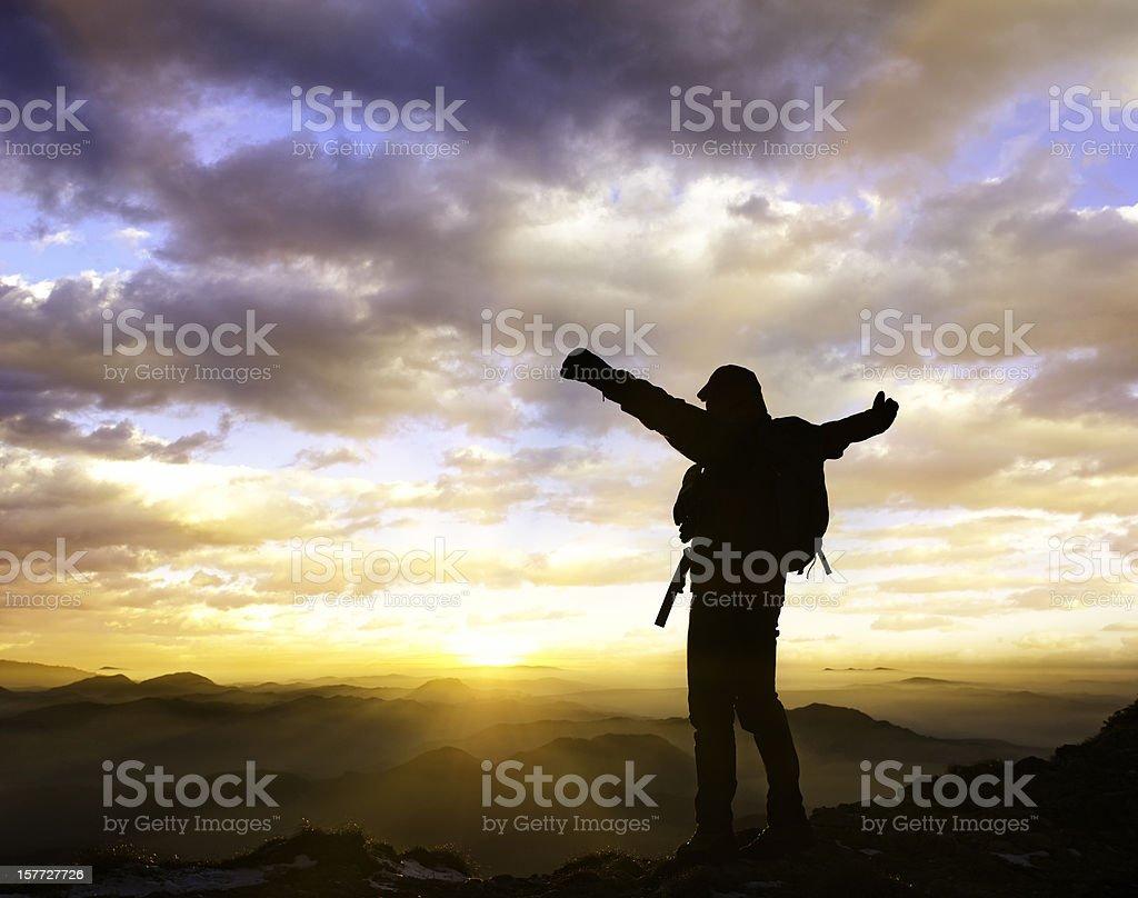 mountaineer enjoying the sunset royalty-free stock photo