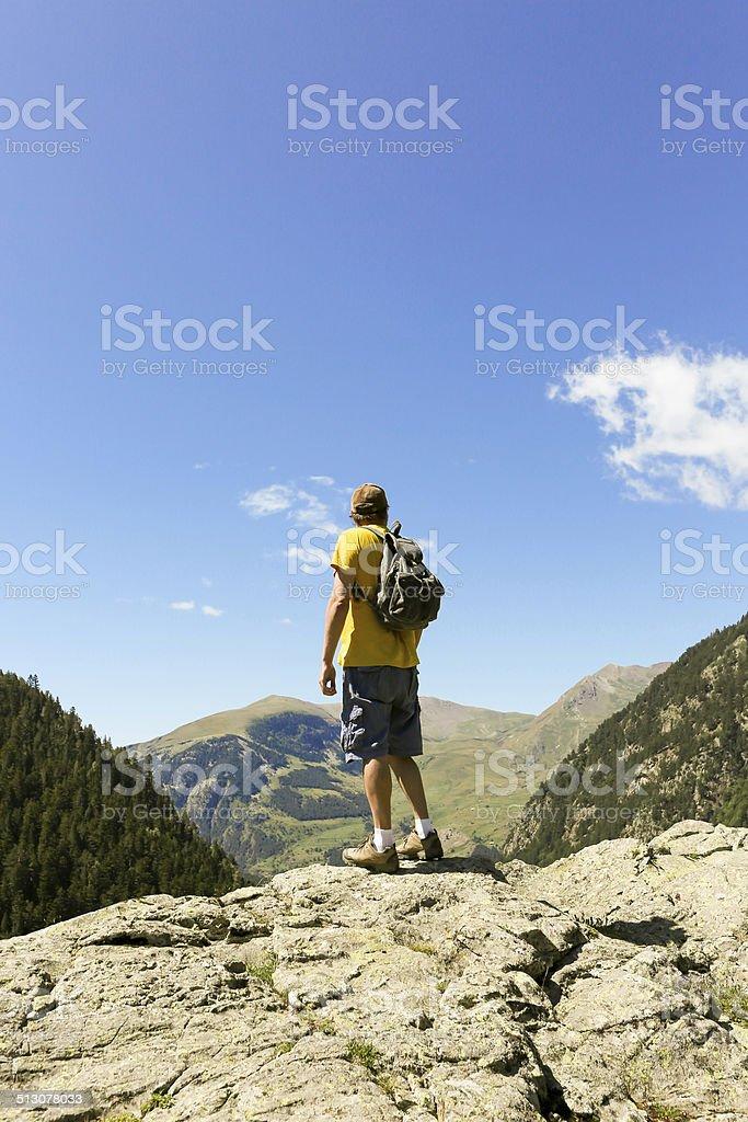mountaineer enjoying the view stock photo