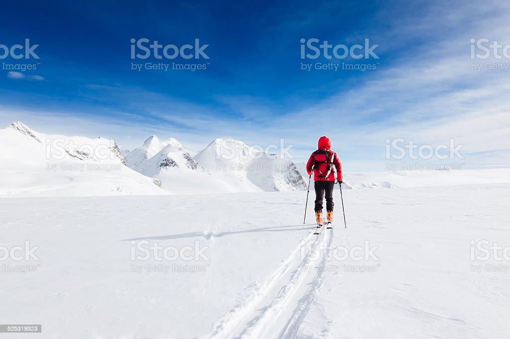 Mountaineer exploring a glacier stock photo