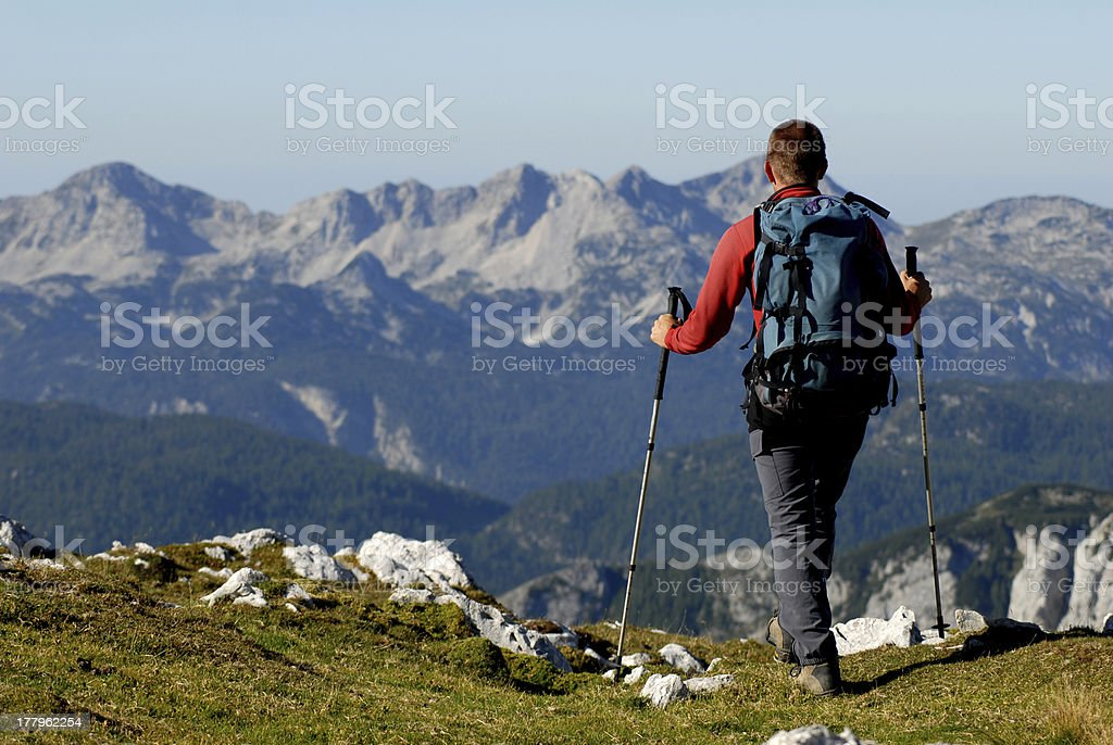 Mountaineer hiking in mountains royalty-free stock photo