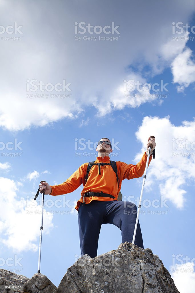 Mountaineer on the top of mountain royalty-free stock photo