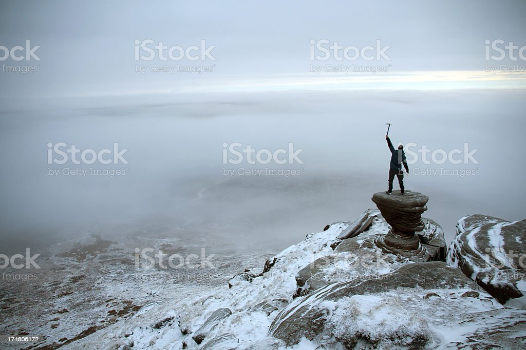 Mountaineer posing at sunrise on Kinder Scout, Peak District stock photo