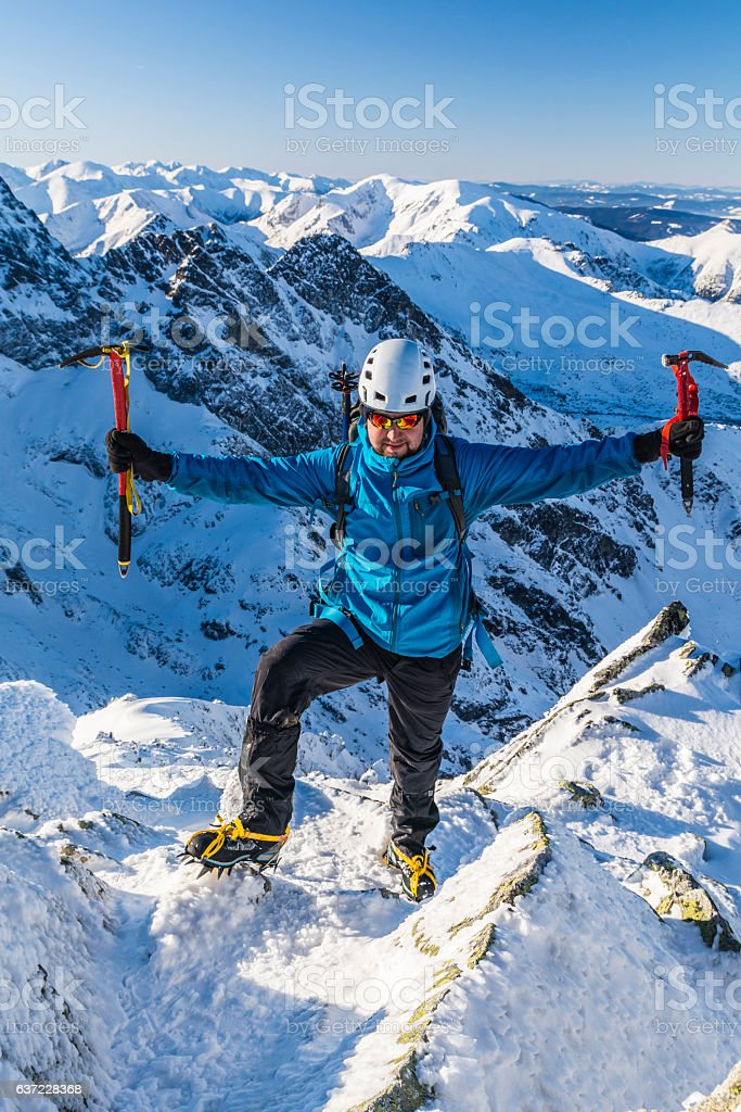 Mountaineer with an ice axes stock photo