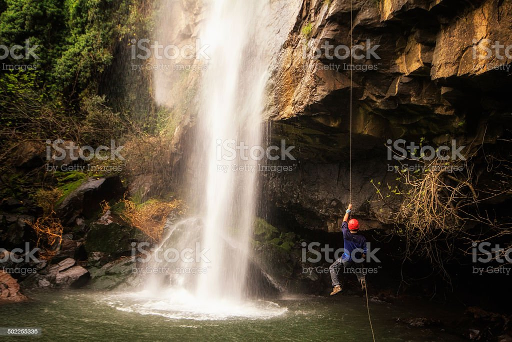 mountaineering spore climb man stock photo
