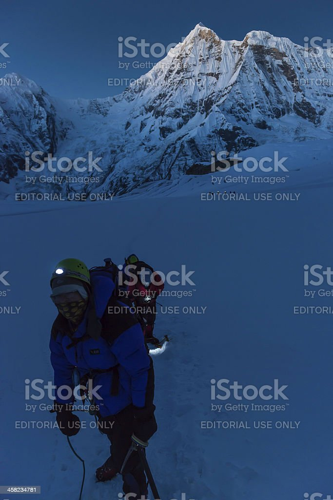 Mountaineers climbing before dawn Himalayas Nepal stock photo