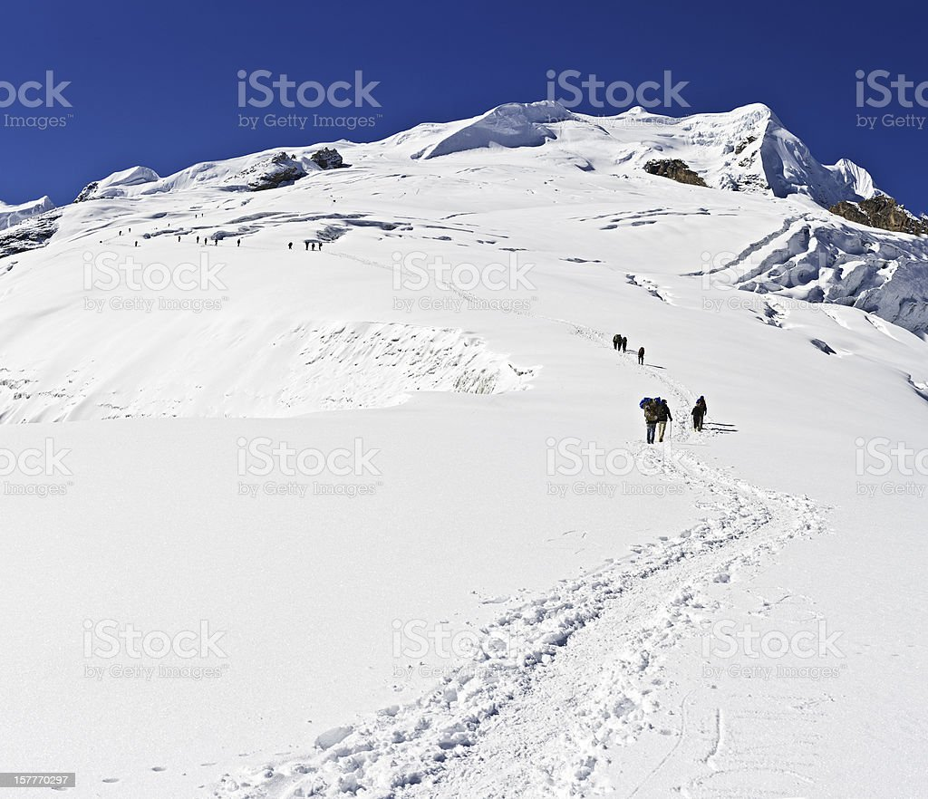 Mountaineers climbing high altitude snow glacier Mera Peak Himalayas Nepal stock photo