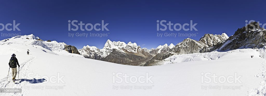 Mountaineers climbing high altitude snow glacier pass winter Himalayas Nepal stock photo