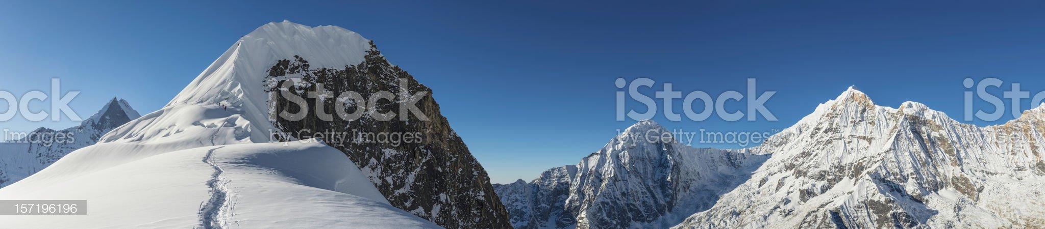 Mountaineers climbing Himalaya mountain peak Nepal royalty-free stock photo