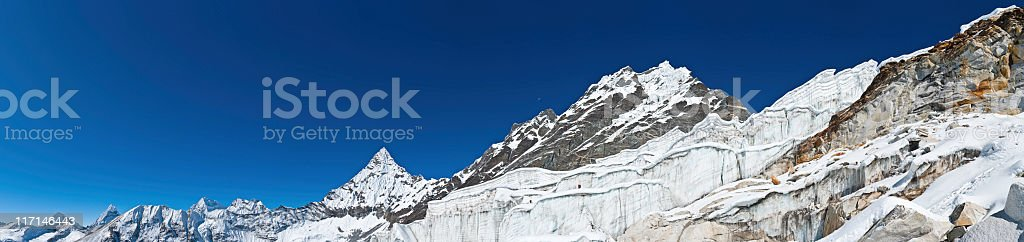 Mountaineers climbing huge icefall glacier peaks panorama Amphulapcha Himalayas Nepal stock photo