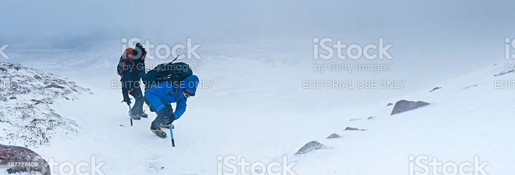 Mountaineers climbing in winter snow storm Cairngorms Scotland royalty-free stock photo