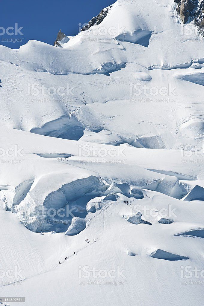 Mountaineers climbing Mont Blanc glaciers Alps France royalty-free stock photo