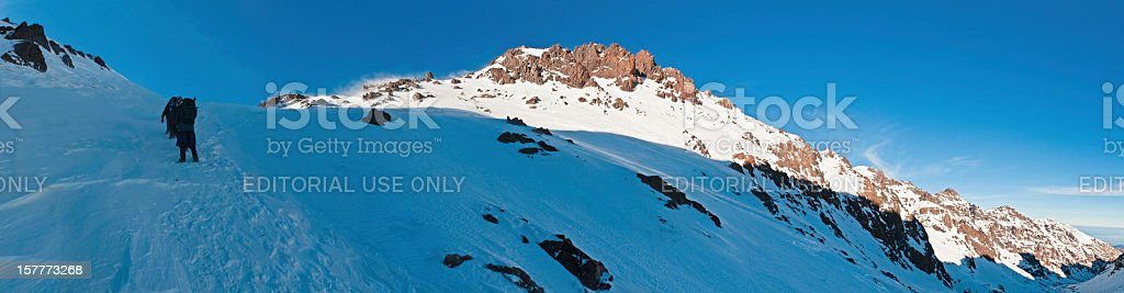 Mountaineers climbing snow couloir to summit Africa royalty-free stock photo