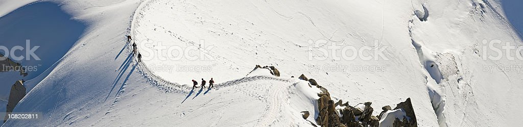 Mountaineers Climbing Snow Covered Ridge royalty-free stock photo
