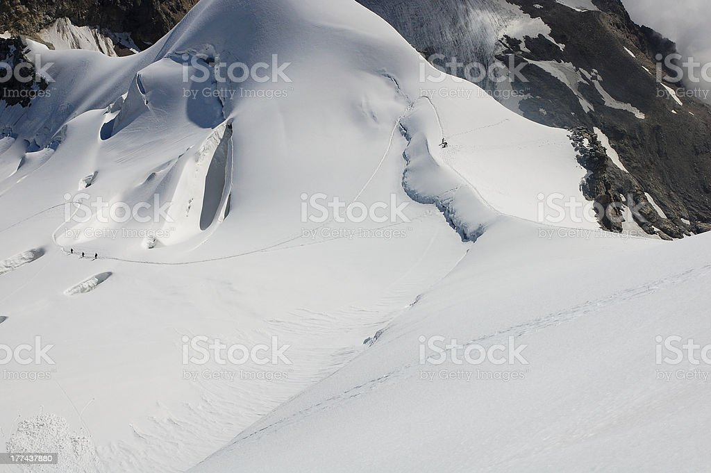 Mountaineers crossing a crevase field stock photo