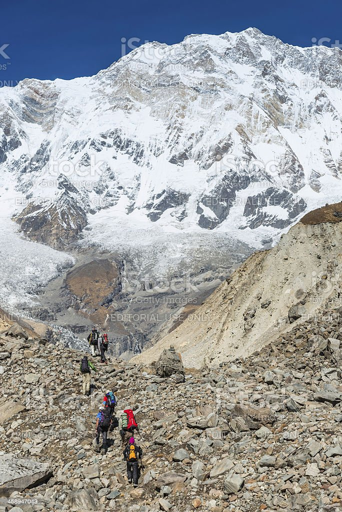 Mountaineers crossing glacier below Annapurna Himalayas Nepal royalty-free stock photo