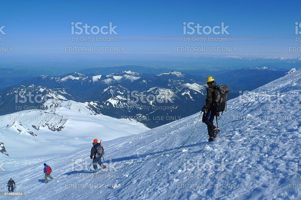 Mountaineers descending Mount Baker stock photo