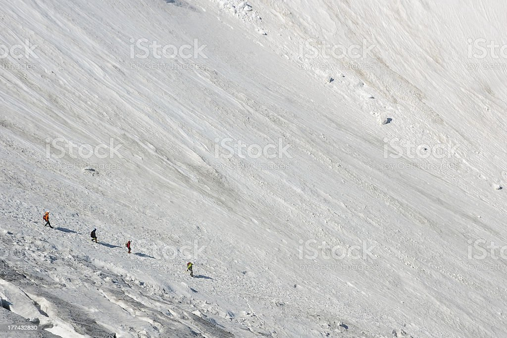 Mountaineers descending on steep ice royalty-free stock photo