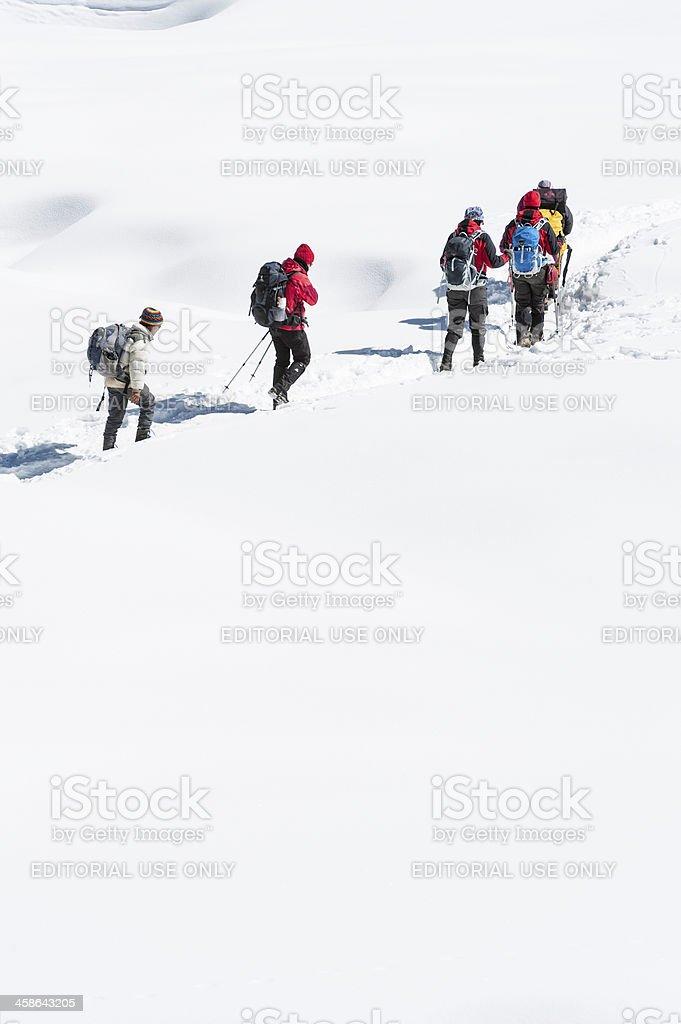 Mountaineers high on snowy glacier stock photo