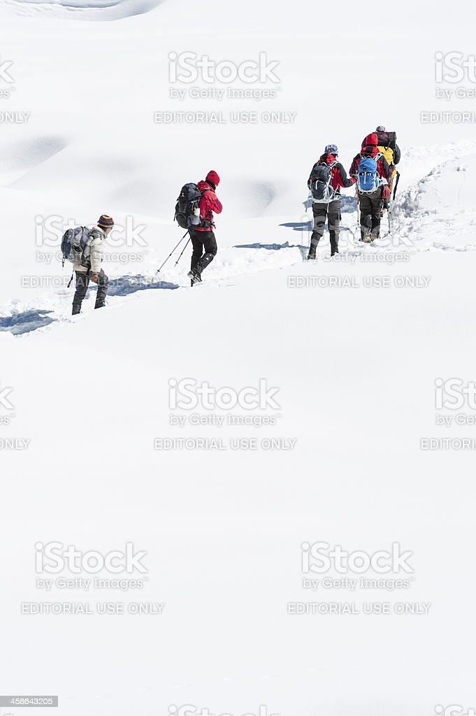 Mountaineers high on snowy glacier stock photo