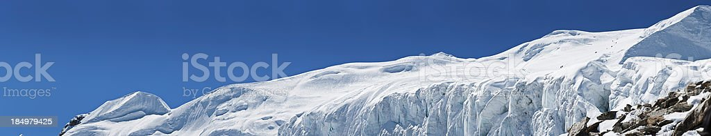 Mountaineers on giant glacier Himalayas Nepal stock photo