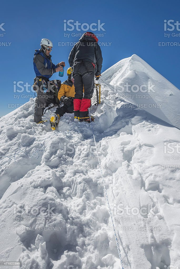Mountaineers on snow capped summit Annapurna Himalayas Nepal royalty-free stock photo