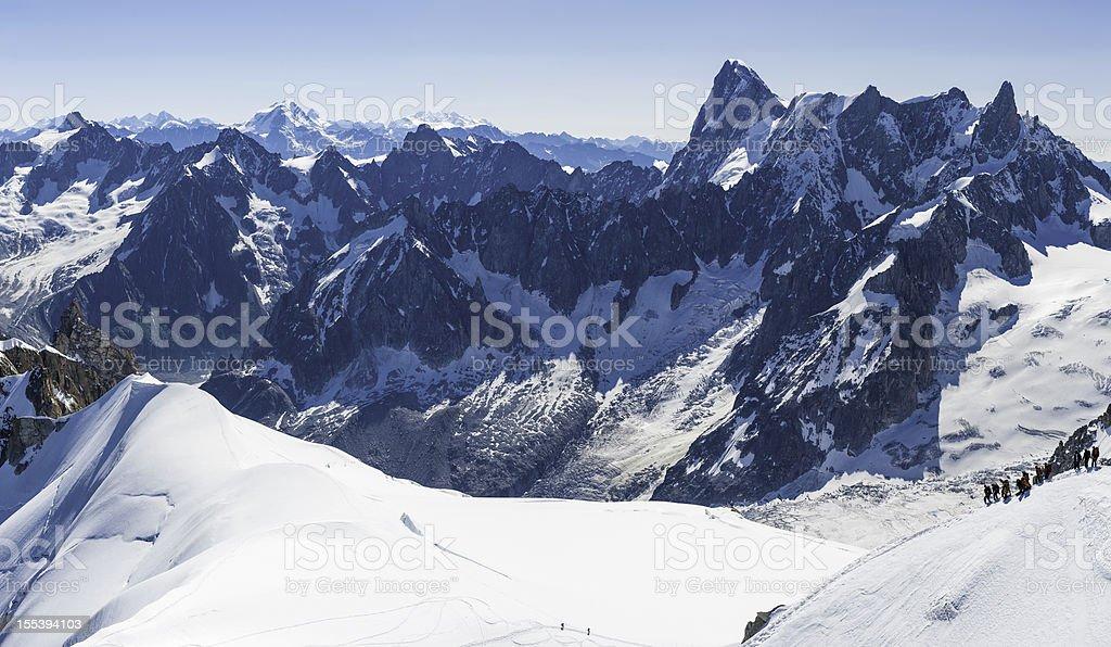 Mountaineers on snowy Alpine ridge French Alps stock photo