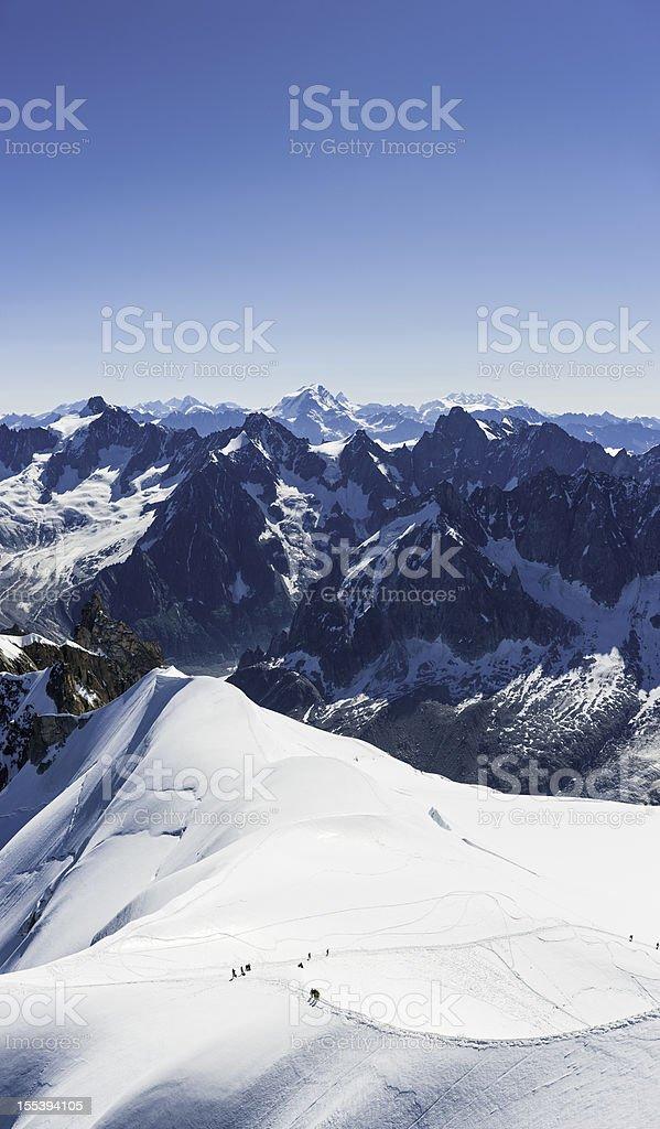 Mountaineers on snowy glacier Alpine peaks stock photo