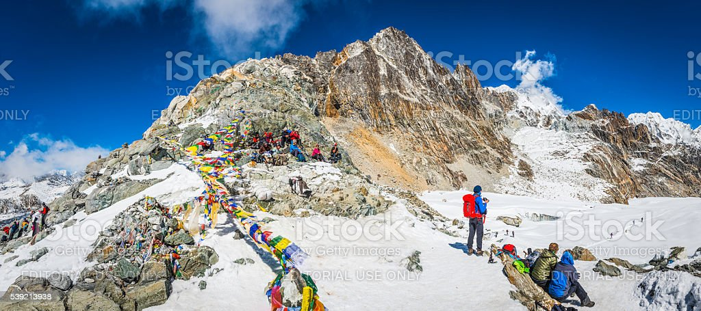 Mountaineers prayer flags Cho La pass Himalaya trekking panorama Nepal stock photo