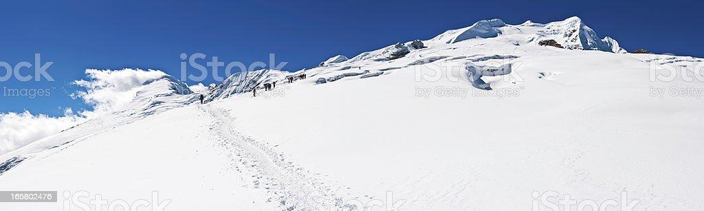 Mountaineers sherpas climbing Mera Peak Himalaya panorama Nepal royalty-free stock photo