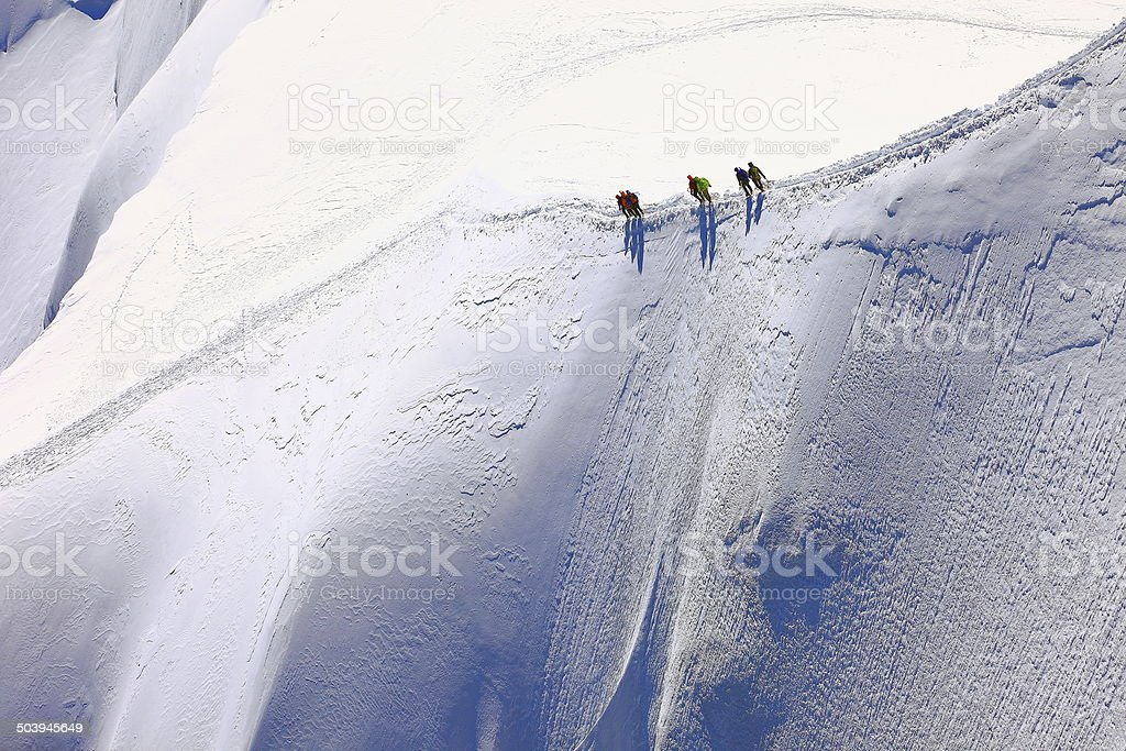 Mountaineers trekkers and Mont Blanc Massif, French Alps, Chamonix stock photo