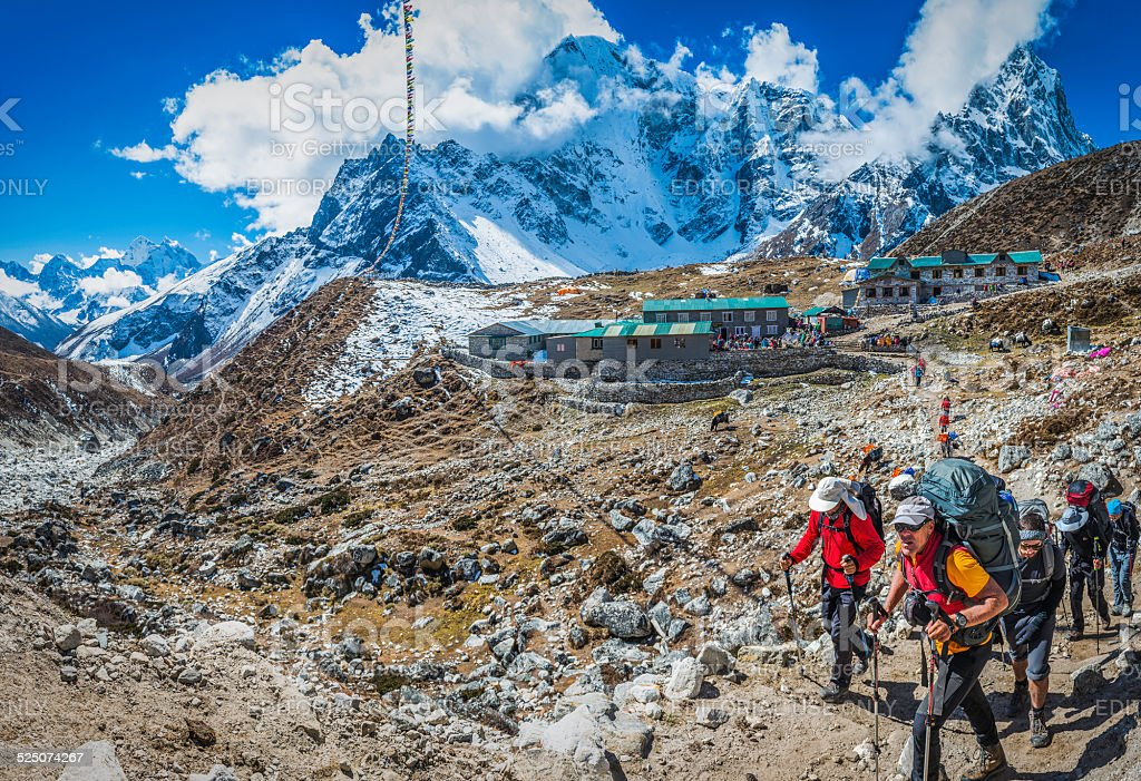 Mountaineers trekking on Everest Base Camp trail Himalayas Nepal stock photo