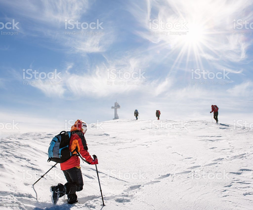 Mountaineers walking up the mountain in winter stock photo
