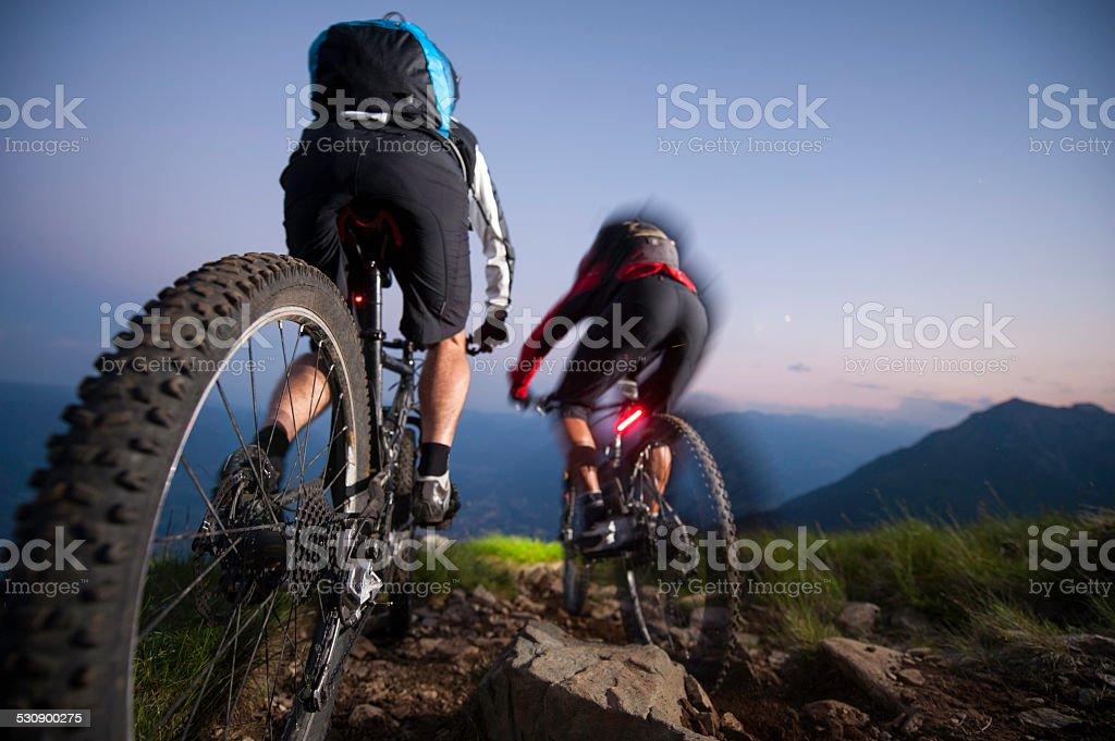 mountaingike downhill by night - blurred motion stock photo