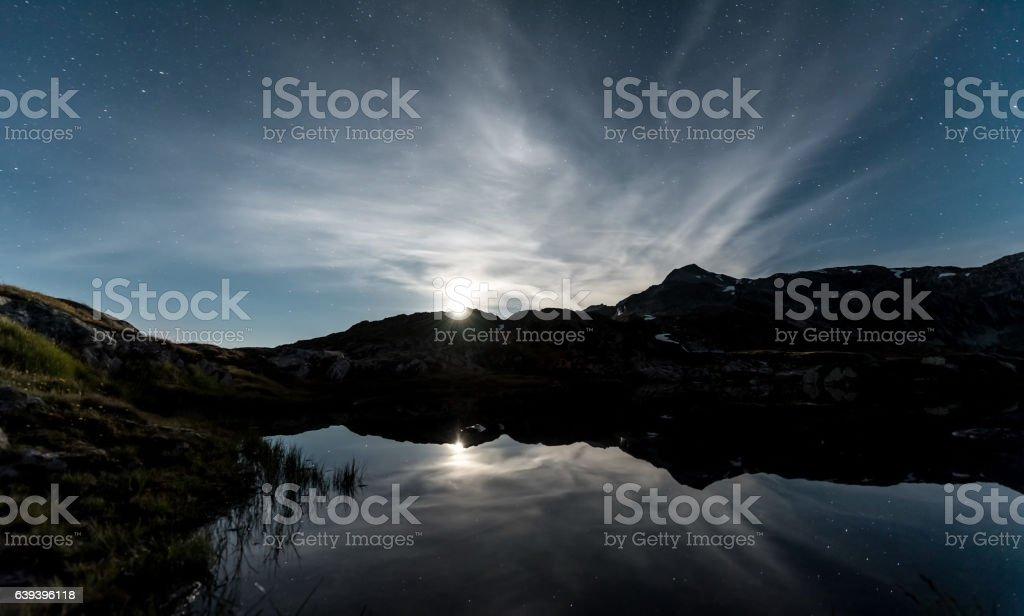 Mountainlake Moonset stock photo
