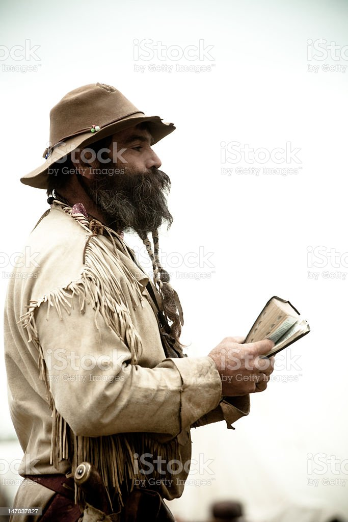 Mountainman standing with bible stock photo