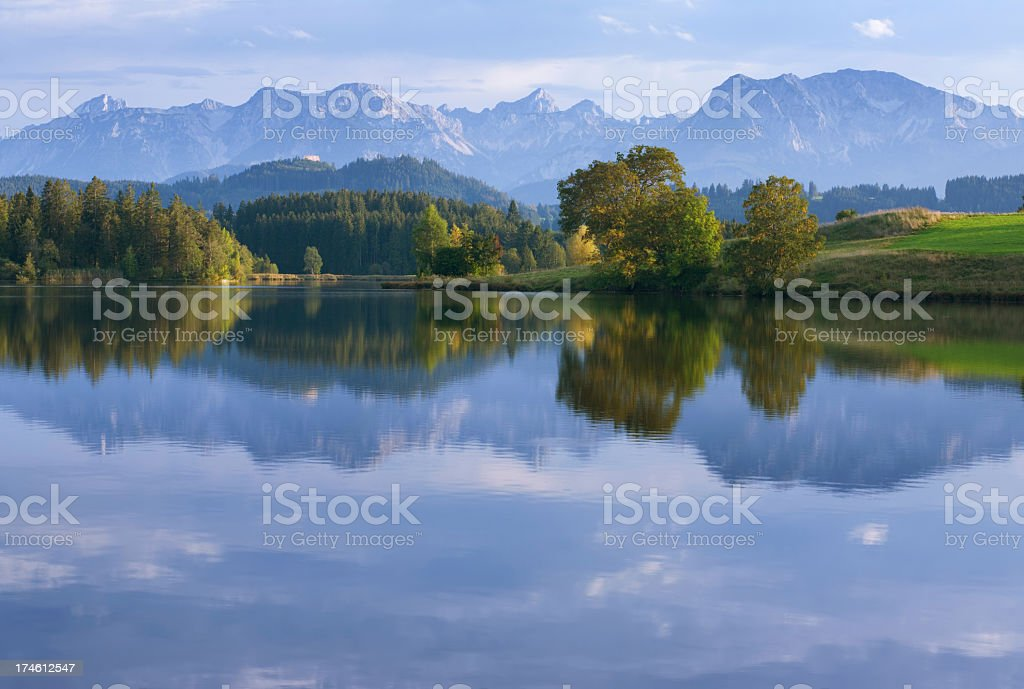 A mountainous forest reflecting in a lake royalty-free stock photo