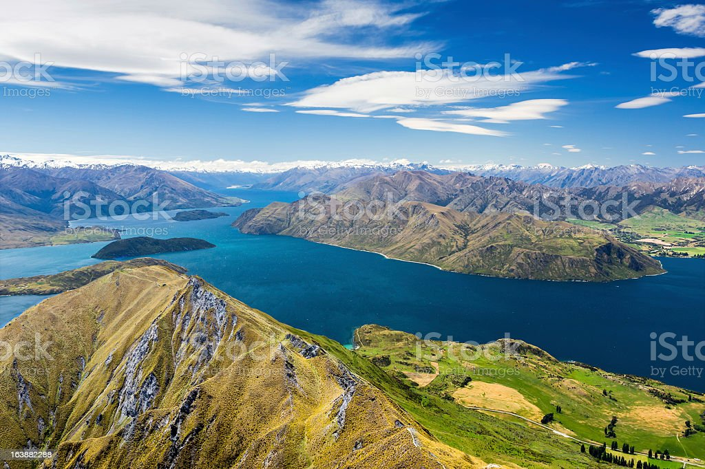 Mountains and blue lake under blue sky with clouds stock photo